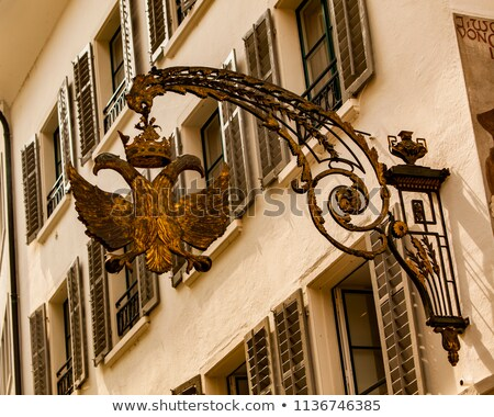 double headed golden eagle sign in lucerne switzerland stock photo © boggy