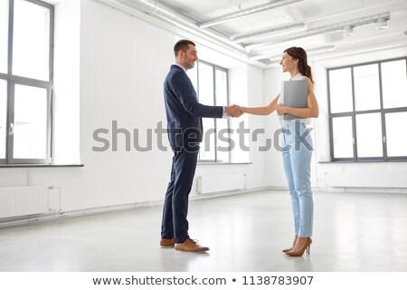 деловая женщина агент по продаже недвижимости папке служба деловые люди корпоративного Сток-фото © dolgachov