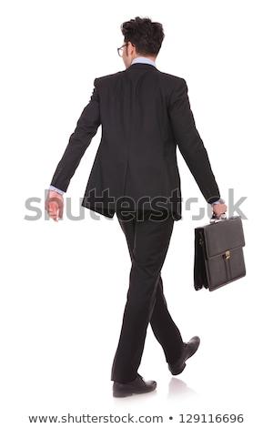 Arkadan görünüm akıllı gündelik adam yürüyüş evrak çantası Stok fotoğraf © feedough