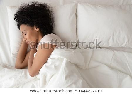 Beautiful black woman on a white bed sleep Stock photo © Lopolo