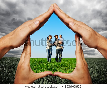 Male And Female Hands Protecting House Model Stock photo © AndreyPopov
