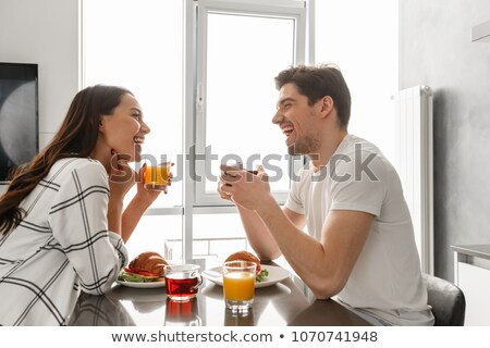 portait of beautiful happy family man and woman looking at each stock photo © deandrobot