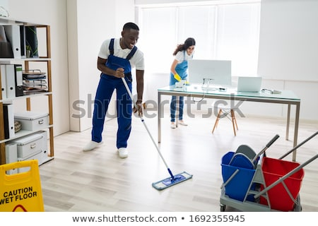 Smiling Two Young Janitor Cleaning The Office Stock photo © AndreyPopov