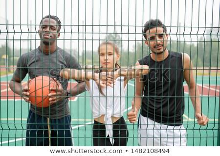 Jóvenes activo mujer dos hombres pie Foto stock © pressmaster