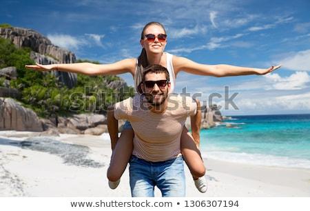happy couple having fun on seychelles island Stock photo © dolgachov