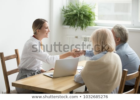 happy young real estate agent congratulating mature clients on successful deal stock photo © pressmaster