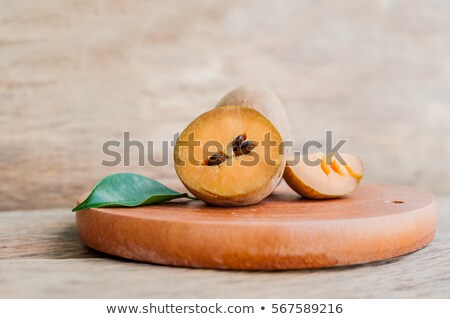 fresh sapodilla fruits on old wooden background Stock photo © galitskaya