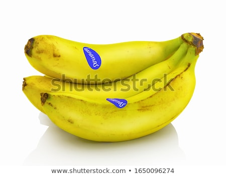 Fresh ripe organic bananas cluster on white background with reflection. Stock photo © DenisMArt