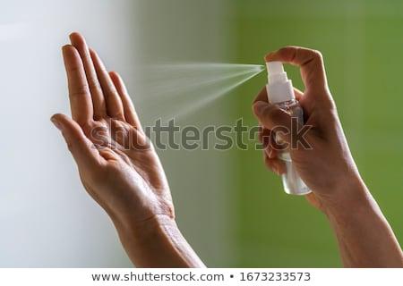 Stock photo: Womans hands and Coronavirus bacteria.