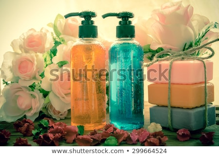 Body care product, shower, shampoo, shower gel on vintage tone with water drop Stock photo © galitskaya
