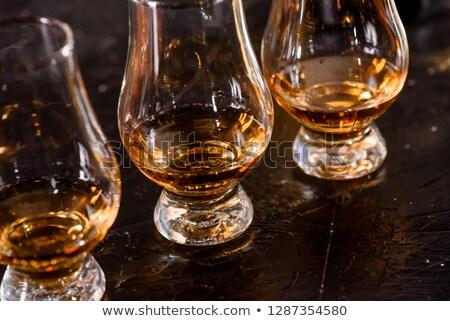 Single malt scotch whiskey in glencairn glass on wooden background Stock photo © DenisMArt
