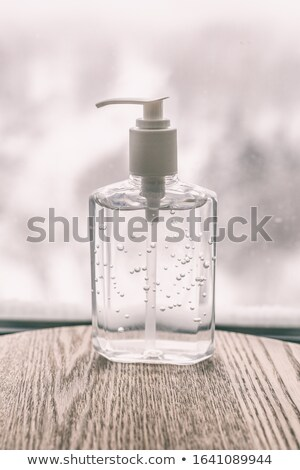 Coronavirus hand sanitizer cleaning gel for washing hands against germs and flu virus. Alcohol based Stock photo © Maridav