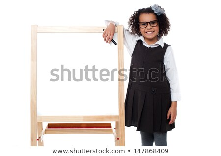 Girl beside boards with marker in hand Stock photo © RuslanOmega