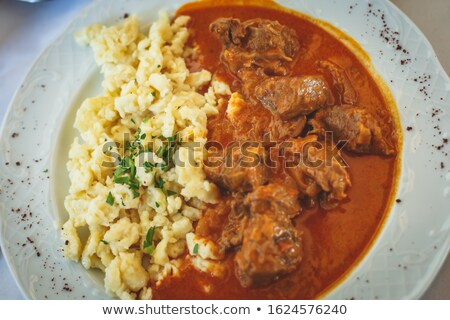 beef goulash with eggs stock photo © phbcz