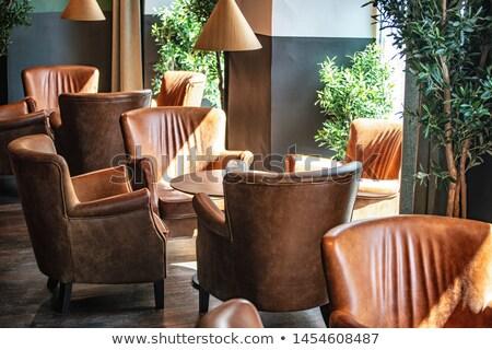 Pelle sedie legno ristorante tavola sedia Foto d'archivio © vlaru