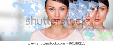 Many identical businesswomen clones in front of digital transpar Stock photo © HASLOO
