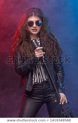 beautiful brunette woman singing at retro nightclub stock photo © hasloo