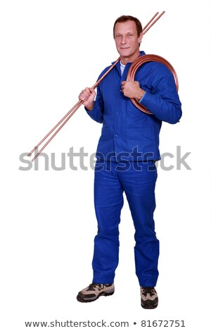 portrait of plumber holding copper pipes Stock photo © photography33