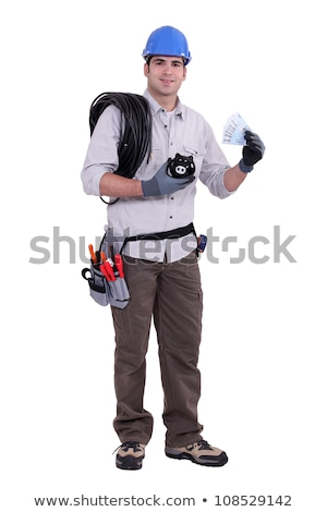 electrician holding piggy bank stock photo © photography33
