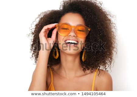 Portrait of fashion young woman in sunglasses isolated on black  Stock photo © Victoria_Andreas