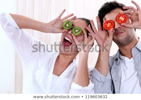 young couple playing around in a studio stock photo © photography33