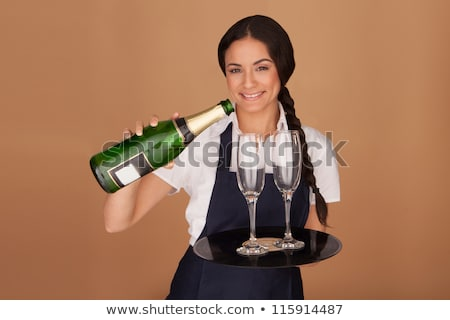 beautiful waitress pouring champagne stock photo © stryjek