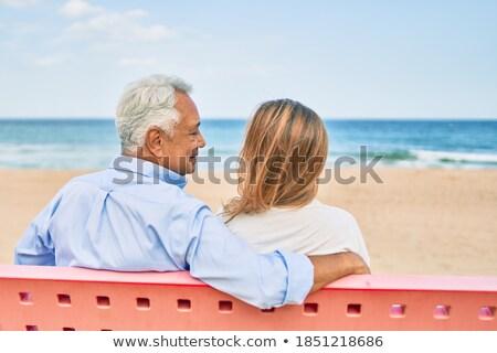 Kadın oturma geri bank su şehir Stok fotoğraf © photography33