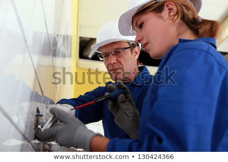 Young woman wiring a plug socket Stock photo © photography33