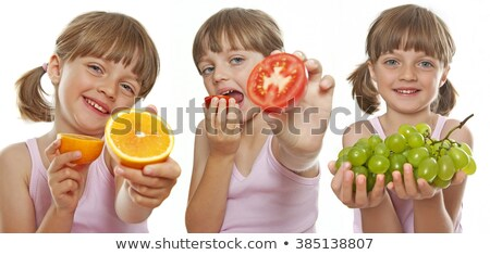 Little girl holding bunch of green grapes Stock photo © photography33