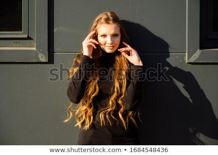 portré · gyönyörű · fiatal · nő · haj · szél · város · fények - stock fotó © carlodapino