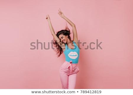 morena · mulher · jovem · posando · forte · backlight - foto stock © carlodapino