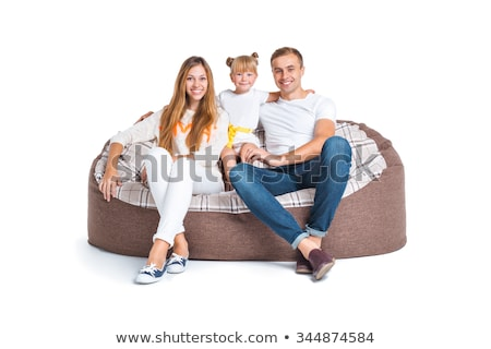 Stockfoto: Charming Family Sitting On A Sofa