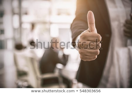 successful businesswoman with thumb up stock photo © wavebreak_media