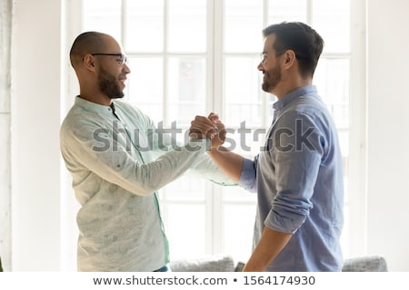 A handshake of two people saying hello to each other Stock photo © wavebreak_media