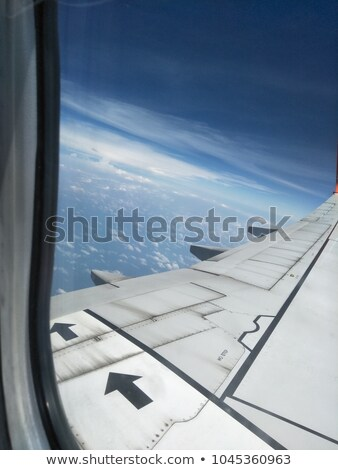 Clouds and sky as seen through door of an aircraft Stock photo © rufous