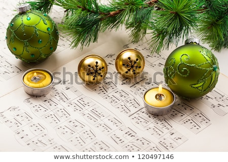 Golden rings on the  sheet music Stock photo © Grazvydas