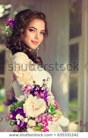 beautiful laughing girl in white corset  Stock photo © evgenyatamanenko