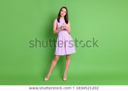 Vrouw groene jurk glimlachend modieus jonge vrouw Stockfoto © stepstock