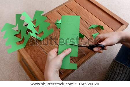 Stock photo: Closeup of cutting a Christmas tree paper chain