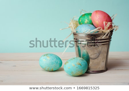 Colourful green Easter eggs in straw Stock photo © juniart
