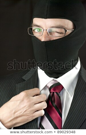Businessman Wearing Balaclava Winks To Camera stock photo © jackethead