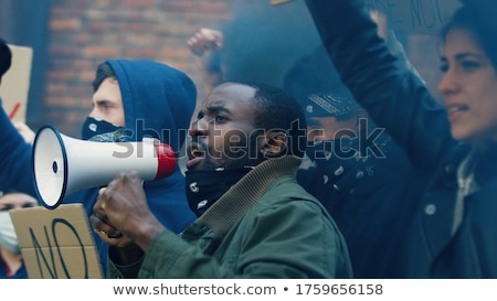 antidisturbios · acto · masculina · calles · humo · grito - foto stock © stevanovicigor