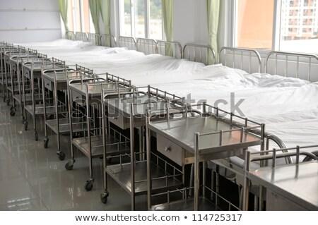 Сток-фото: Row Of Empty Beds In Hospital Corridor