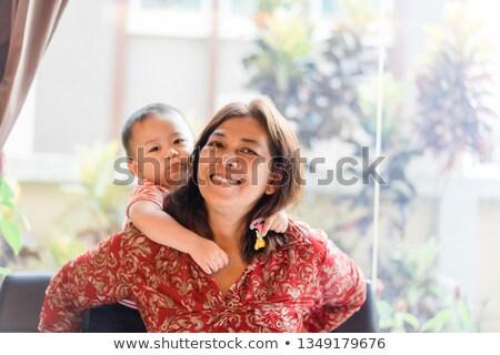 мальчика играет матери бабушки семьи , держась за руки Сток-фото © bmonteny