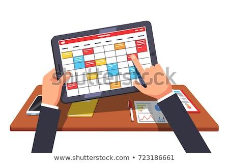 Businessman taps digital tablet computer Stock photo © stevanovicigor