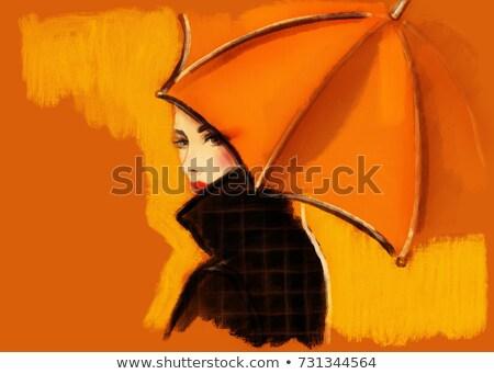 Beautiful elegant woman with an orange umbrella Stock photo © smithore