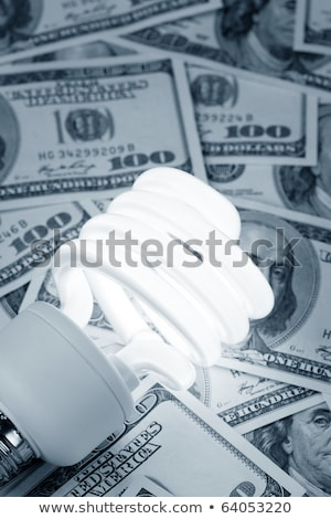Stockfoto: Compact Fluorescent Light Bulb And Dollar