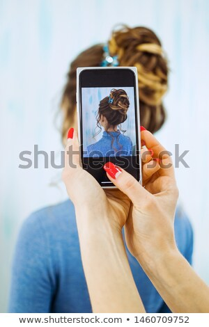 female hand with mobile phone elephant Stock photo © compuinfoto