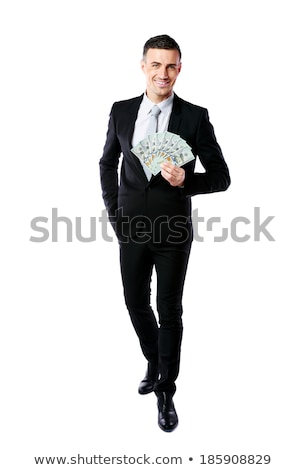 Full-length portrait of businessman holding US dollars isolated on a white background Stock photo © deandrobot