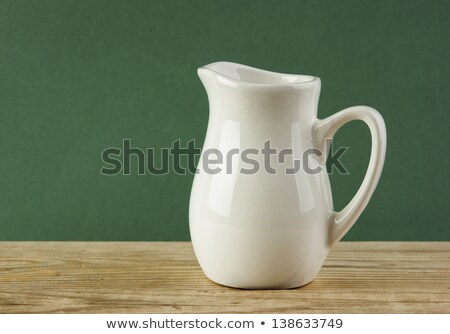 white ceramic jug over white stock photo © lucielang